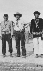 Navajo men wearing concho belts