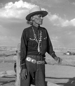 elderly man in traditional Navajo dress wearing a concho belt