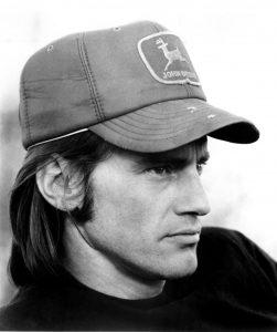 Sam Shepard wearing a trucker hat
